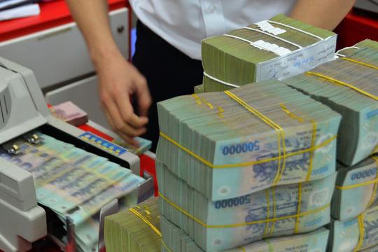 Ngân hàng Nhà nước quyết tâm xử lý tận ngọn nợ xấu - Hình 1