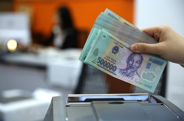 Agribank góp phần đẩy nhanh quá trình xử lý nợ xấu - Hình 1