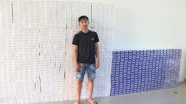 Đối tượng Nguyễn Văn Minh cùng tang vật.