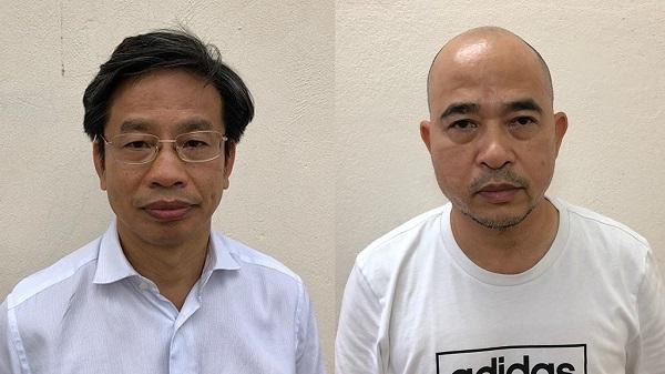 Bị can Nguyễn Xuân Sơn (bìa trái) và bị can Vũ Trọng Hải (bìa phải)
