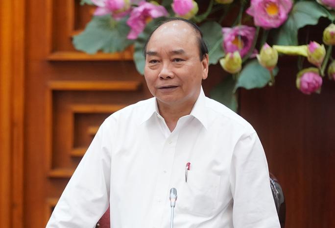 Thủ tướng Chính phủ Nguyễn Xuân Phúc yêu cầu EVN làm rõ thông tin người dân phản ánh hóa đơn tiền điện cao bất thường (Ảnh: Quang Hiếu)