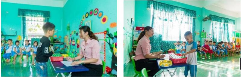 Các bé mầm non Hoa Hồng, huyện Sơn Hà đã bắt đầu quen với giờ uống sữa tại trường với sự hướng dẫn của các cô giáo.