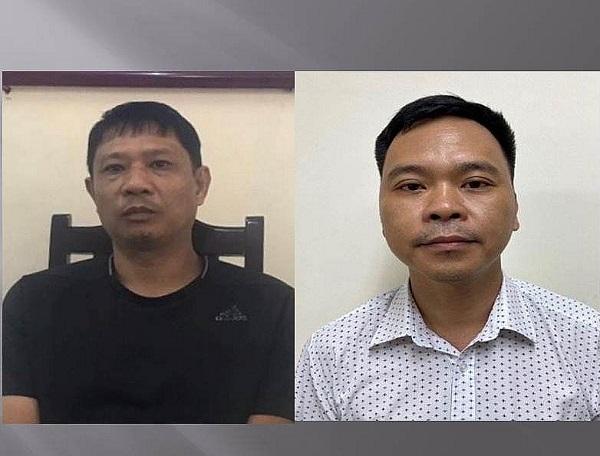Bị can Bùi Quốc Việt (áo đen) và Võ Việt Hùng. Ảnh: Bộ Công an.