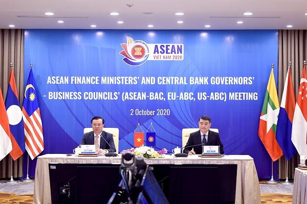 Bộ trưởng Bộ Tài chính Việt Nam Đinh Tiến Dũng và Thống đốc Ngân hàng Nhà nước Việt Nam Lê Minh Hưng đồng chủ trì Hội nghị