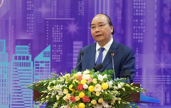 """Thủ tướng Nguyễn Xuân Phúc nêu rõ, phát triển đô thị thông minh thực sự là một """"cuộc chơi lớn"""", trong đó cần có những """"người cùng chơi"""" có """"tầm nhìn"""" và """"tiềm lực"""". Ảnh: VGP/Quang Hiếu"""