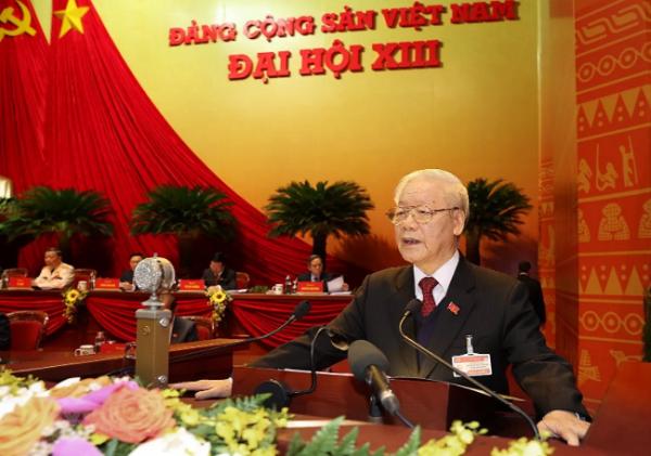 Tổng Bí thư Ban Chấp hành Trung ương Đảng, Chủ tịch nước CHXHCN Việt Nam Nguyễn Phú Trọng đọc Báo cáo chính trị của Ban Chấp hành Trung ương Đảng khóa XII và các văn kiện trình Đại hội.