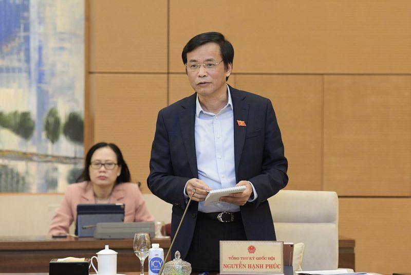 Tổng Thư ký, Chủ nhiệm Văn phòng Quốc hội Nguyễn Hạnh Phúc trình bày Báo cáo một số vấn đề về việc chuẩn bị Kỳ họp thứ 11 Quốc hội Khóa XIV.