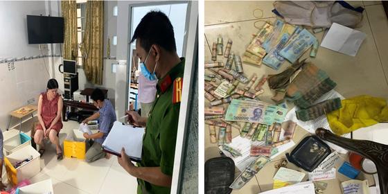 Khám xét nơi ở của Nguyễn Thị Thủy Liên và tiền, tang vật bị thu giữ