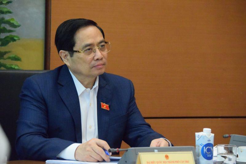 Thủ tướng Phạm Minh Chính tham dự phiên thảo luận tại tổ đại biểu Quốc hội - Ảnh: VGP/Nguyễn Hoàng
