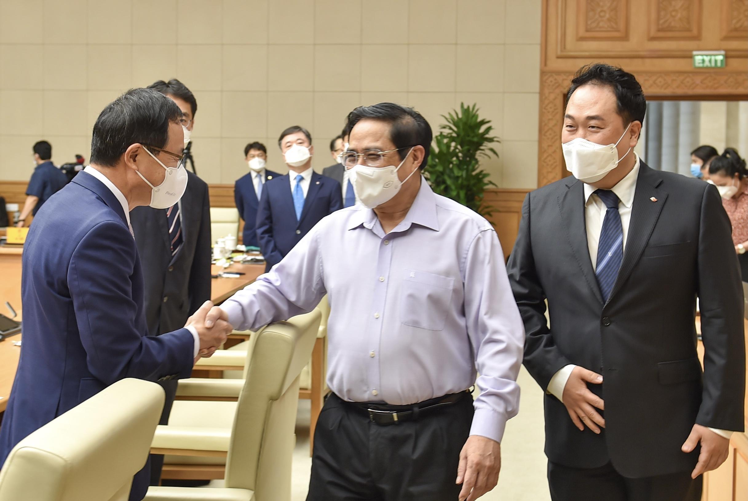 Thủ tướng Phạm Minh Chính và các đại biểu dự cuộc làm việc - Ảnh: VGP/Nhật Bắc